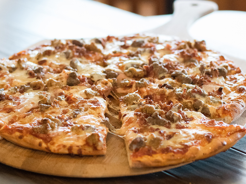 Five Meat Pizza made with Pepperoni, Sausage, Hamburger, Bacon, and Canadian Bacon