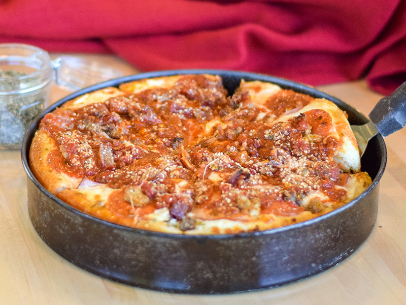 Deep Dish Works Pizza comes with pepperoni, sausage, hamburger, red onions, and mushrooms
